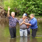 Dean baptizing Bill Keene