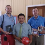 Mission Team Presenting Bibles Soccer Balls Candy To Children